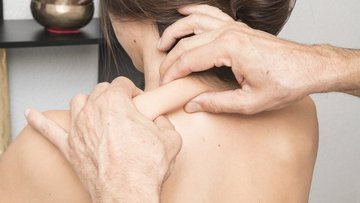 Women receiving treatment for pain in the shoulder.