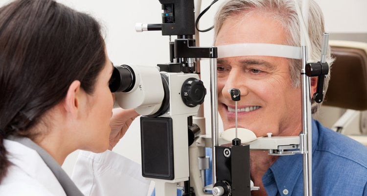 Healthcare provider performing visual field examination of the eye.
